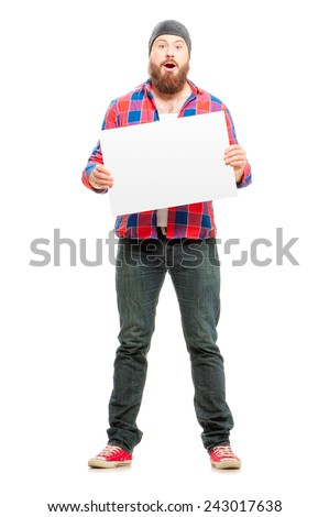 Full length of surprised bearded young man in casual wear holding copy space while standing isolated on white background - stock photo