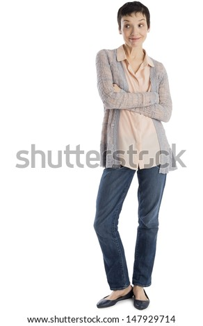Full length of surprised mature woman standing arms crossed against white background - stock photo