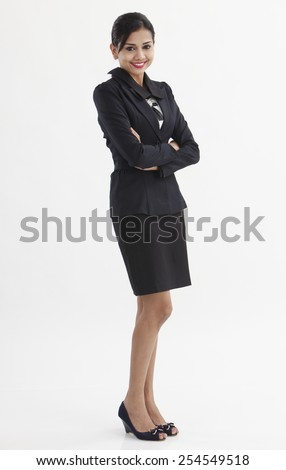 full length of the businessman crossed her arm - stock photo