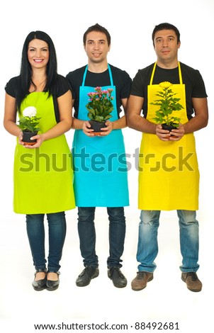 Full length of three florists team holding flowers in pots isolated on white background