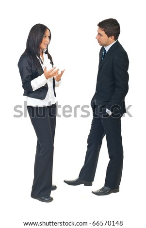 Full length of two business people having a conversation and woman explaining something to man isolatedon white background