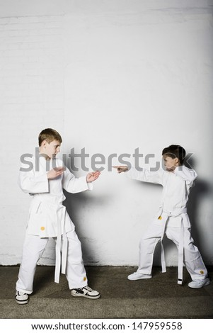 Full length of two young boys practicing judo - stock photo