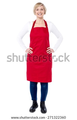 Full length of woman chef with hands on her waist - stock photo