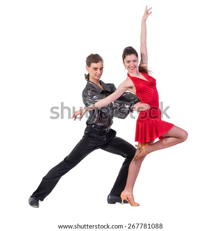 Full length of young ballet couple dancing against isolated white background - stock photo