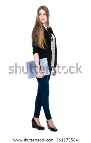 Full length of young blond smiling girl holding clipboard looking back. Isolated on white background.