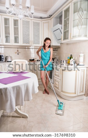 Full Length of Young Brunette Woman Performing Household Chores by Mopping Floor in Clean Kitchen