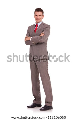 Full length of young business man standing with arms folded isolated on white background