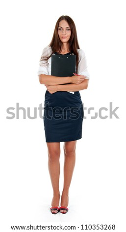 Full length of young business woman holding clipboard over white background - stock photo