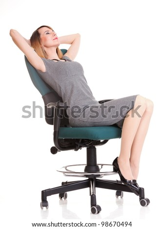 Full length of young business woman sitting on the chair over white background relaxing