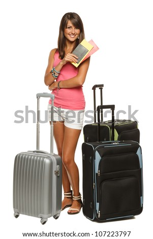 Full length of young female in casual standing with travel bags, holding passport and tickets, isolated on white background