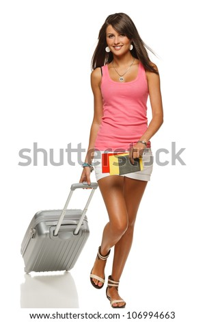 Full length of young female in casual walking with the travel bag, isolated on white background