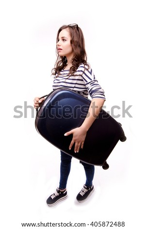 Full length of young female in casual walking with the travel bag, isolated on white background - stock photo