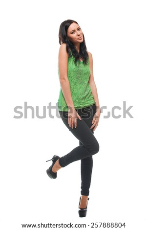 Full length of young female model standing over white background - stock photo