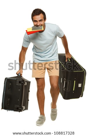 Full length of young male tourist hurrying to the flight holding tickets with passport in his teeth, isolated on white background - stock photo