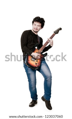 Full length of young man in a suit with guitar over white background - stock photo