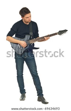 Full length of young man playing guitar isolated on white background - stock photo