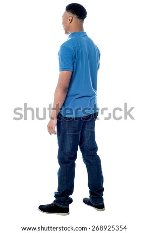 Full length of young man walking ahead - stock photo
