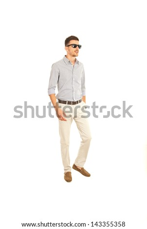 Full length of young man walking isolated on white background - stock photo