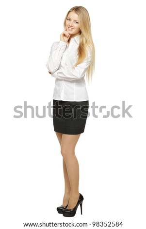 Full length of young smiling female standing with folded hands, isolated on white background - stock photo