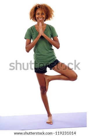 Full length of young smiling woman doing yoga exercise isolated over white background