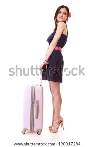 Full length of young summer fashion woman with pink suitcase luggage bag looking at wrist watch isolated on white background. Travel vacation concept.