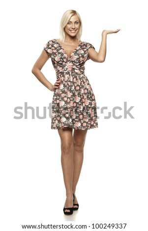 Full length of young woman showing a product - empty copy space on the open hand palms, over white background