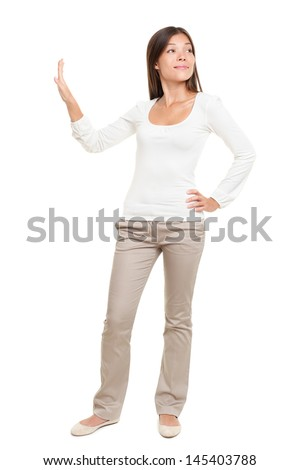 Full length of young woman with hand on hip making stop gesture isolated over white background - stock photo