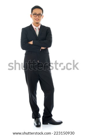 Full length pan Asian business man crossed arms standing isolated on white background. - stock photo