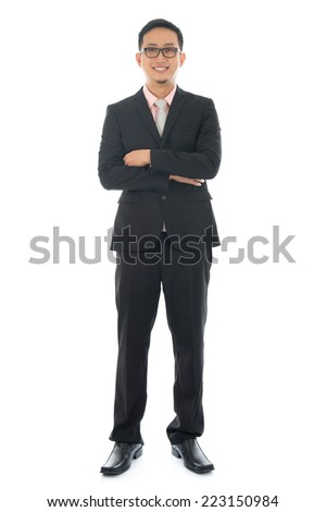 Full length pan Asian businessman crossed arms standing isolated on white background. - stock photo