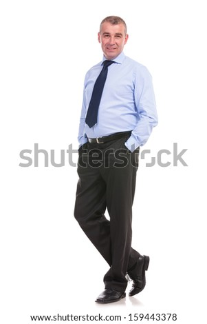 full length picture of a business man standing with his hands in his front pockets and looking into the camera. on a white background - stock photo