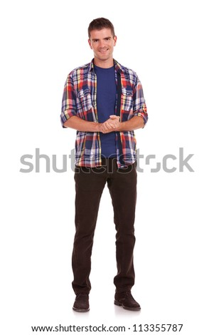 Full length picture of a casual young man standing with his palms together, being thankful