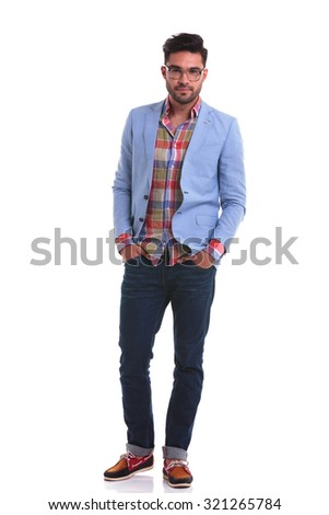 Full length picture of a fashion man standing with his hands in pockets on isolated background. - stock photo