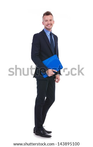 full length picture of a young business man holding a clipboard and smiling for the camera. on white background