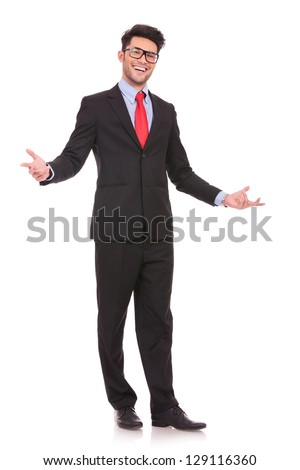 full length picture of a young business man welcoming everybody with his arms wide opened and with a large smile on his face, on white background - stock photo