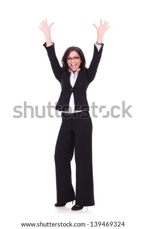 full length picture of a young business woman cheering with her hands in the air. on white background