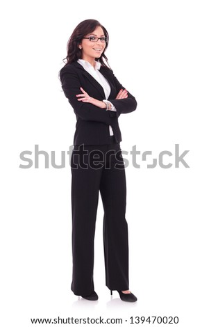 full length picture of a young business woman standing with her hands folded and looking at the camera with a smile on her face. on white background