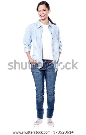 Full length picture of woman with hands in pockets
