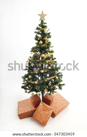 full length plastic christmas tree simply decorated with gold ornaments and tinsel gold star - Plastic Christmas Tree