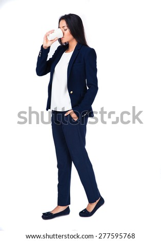 Full length portait of a businesswoman drinking coffee over white background - stock photo