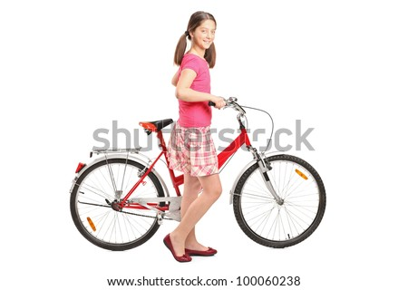 Full length portrait a girl holding a bike isolated on white background - stock photo