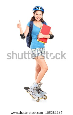 Full length portrait a girlon rollers holding notebooks and giving thumb up isolated against white background