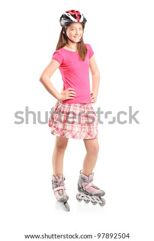 Full length portrait a happy girl on rollers isolated on white background