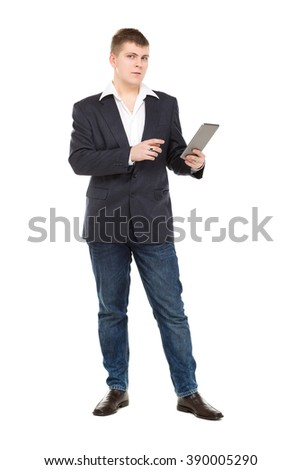 Full Length Portrait Confident Young Businessman with a Modern Tablet Pc, isolated on white background