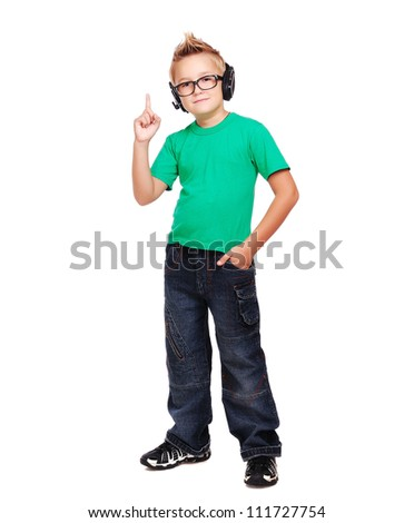 Full length portrait if a stylish boy in headphones pointing with finger - stock photo