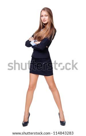Full length portrait of a beautiful business woman standing with hands folded against isolated on white background
