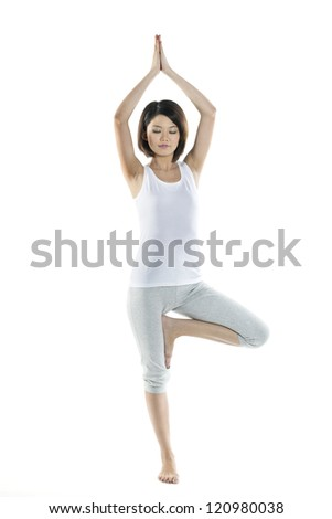 Full length Portrait of a beautiful Chinese woman doing yoga exercise - stock photo