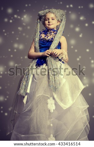 Full length portrait of a beautiful girl who looks like a little snow Queen.