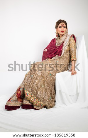 full length portrait of a beautiful indian bride. - stock photo