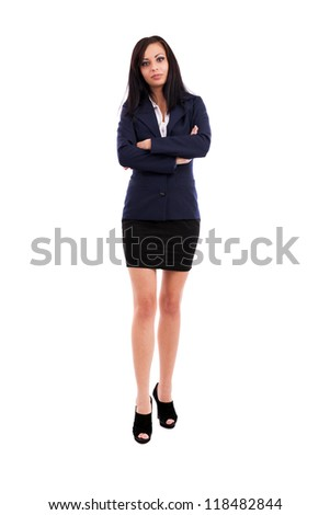Full length portrait of a beautiful latin businesswoman standing with crossed arms isolated on white background