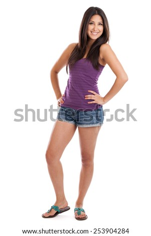 Full length portrait of a beautiful mixed race Mexican Japanese woman standing with hands on hips in casual tank top isolated on white - stock photo